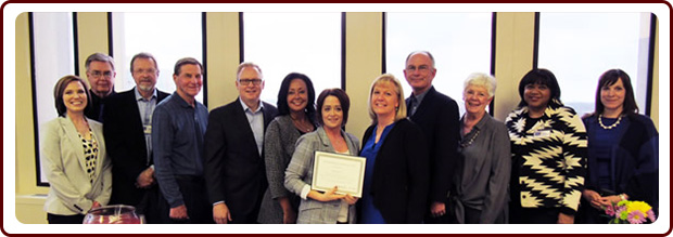 The Kansas Foundation for Medical Care, inc (l to r) Sarah Irsik-Good, CEO and President; Dr. Bob Cox; Dr. Brian Wolfe; Tom Hintz; Dr. Ryan Spaulding; Lynn Biot Gordon, COO and co-Founder of NCCDP; Brenda Groves, 2019